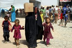 This photo shows families collecting aid in the Khazir Refugee Camp in Northern Iraq.