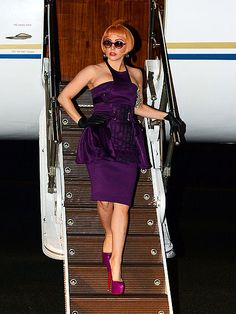 A prim-and-proper looking Lady Gaga donned round, purple sunnies with colored lenses as she arrived in Australia for her Born This Way tour