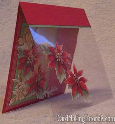 handmade Christmas card ... poinsettias ... card front made from clear acetate with a pair of fussy cut poinsettias  on top ... Inside layer shows a panel of lovely poinsettia patterned paper ...