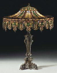 A LEADED GLASS AND BRONZE TABLE LAMP  AMERICAN, THE BASE BY GORHAM CO., CIRCA 1910