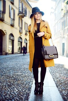 Kayture's Kristina Bazan in a Zalando Collection by Kaviar Gauche trench coat, shoes, and dress, Diane Von Furstenberg bag, Swatch watch and a Guess hat.