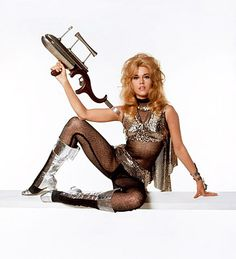 And Jane Fonda with yet another space gun as Barbarella, 1968