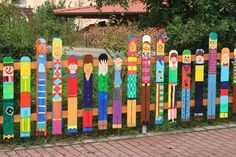 Interesting garden fence design ideas. Next year with Grand boys... all of them.. Make a post for each. What ever they want it to be. YES