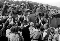 Ethnic German Volksdeutsche greet Wehrmacht soldiers in Tczew, Poland during the German invasion (September 1, 1939). Tczew was the location of the start of the war in Europe when German bombers attacked Polish sapper installations to prevent the town's bridge from being blown up.