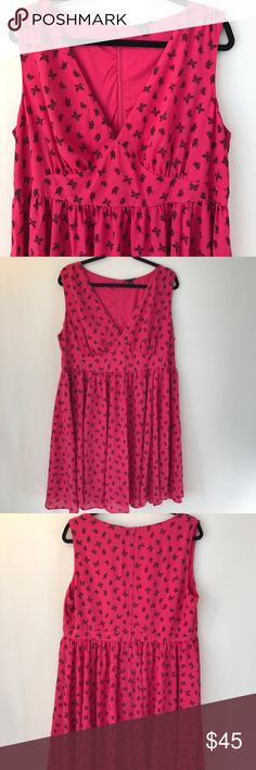 NWOT Pink Butterfly Dress Gorgeous dress for a for gorgeous one. Flirty pink dress with butterflies prints all over. torrid Dresses