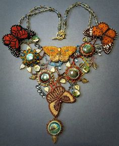 Last flutter of autumn is one of a kind necklace, which combines bead embroidery and freeform beading, rain drops, bright butterflies and
