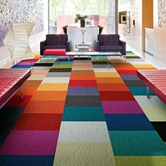 we could use these bright colored flor tiles to create that chevron carpet shown in the photo below.