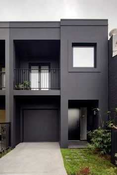 Black paint has been applied across the front and rear elevations, and all of the windows have been refitted with black window frames. A black-frame balustrade has also been set in front of the home's first-floor balcony. Residential Architecture, Interior Architecture, Interior Design, Black Window Frames, Painted Brick Walls, Moving Walls, Melbourne, White Sideboard, Black Exterior