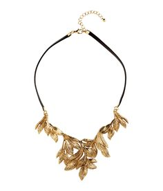 Help her make a statement with this faux leather collar necklace with gold metal foliage design. | H&M Gifts