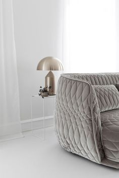 Curated and Ethereal Apartment by Studio Oink - NordicDesign - amazing grey sofa and gold table lamp