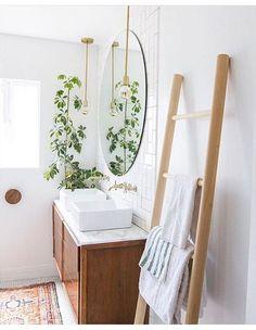 Bright white bathroom, towel ladder, vintage rug