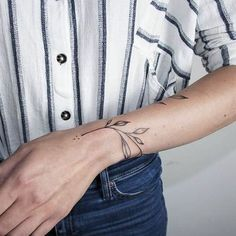 Vine wrist tattoo More