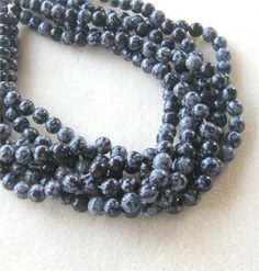Snowflake Obsidian Round Beads, Jewelry Design, Gemstone Beads, Craft Supply, Jewelry Making Bead, Obsidian Bead, Gray Black, 15 Strand 8mm   Gray and black snowflake obsidian beads are featured in this listing. These bead have a good polish, measure 8mm in size and come on a 15 strand with about 50 beads per strand. Must see to appreciate!   Each strand is randomly selected from the group shown.    Although colors show true on my monitor they may show different on yours due to the color…