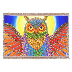 """Colorful Rainbow Owl throw blanket by Rebecca Wang on Zazzle.  The blanket measures 54"""" long by 38"""" wide and is made from 75% cotton and 25% polyester.  Blanket is very soft and has a tassel trim."""