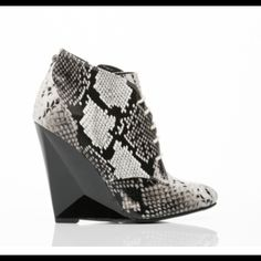 "Williams by Take Out bootie! 4 1/2"" heel, 1/4"" platform, super cute snake skin bootie. Never worn and comes with box! Runs a little small. Sold out on Sole Struck. You can check out the video of the shoe on www.solestruck.com/takeout-Williams-black-white-snake/index.html Take Out Shoes Ankle Boots & Booties"