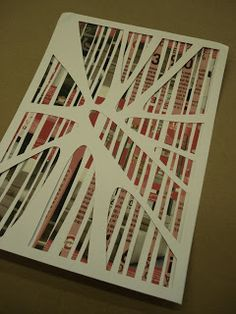 recycled materials- magazine paper cut into strips, then a cut out piece of card stock layer on top