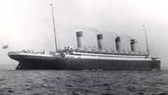 R.M.S Olympic, sometime after the Titanic disaster. (Notice the boat deck filled along the entire side and with two full-size lifeboats at each pair of davits.)
