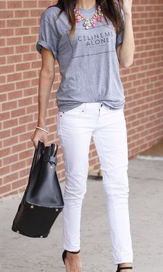 graphic tee statement necklace white skinnies black handbag and heels