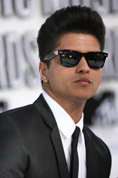 "Bruno Mars....... ""When I see your face,There's not a thing that I would change Cause you're amazing, Just the way you are ,And when you smile,The whole world stops and stares for a while, Cause girl you're amazing ......Just the way you are"""