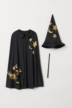 Costume set in soft jersey with printed foil motifs. Cape with collar and hook-loop fastener at top. Padded wizard hat with satin lining. Wand in jersey-covered plastic. Length 11 in. Wizard Costume For Kids, Cute Witch Costume, Harry Potter Halloween Costumes, Kids Costumes Boys, Witch Costumes, Boy Costumes, Halloween Costumes For Kids, Costume Ideas, Halloween Sewing