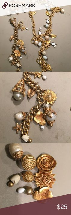 Parure: Kate Hines bracelet, necklace and pin Floral themed Kate Hines jewelry: pansies, roses, daffodils, and sunflowers decorate these pieces, along with leaves and other baubles. Kate Hines Jewelry Necklaces