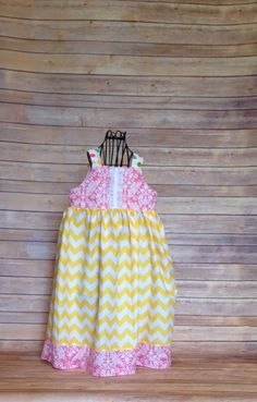A personal favorite from my Etsy shop https://www.etsy.com/listing/225634054/boutique-girls-yellow-chevron-pink