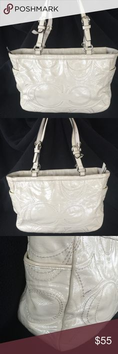 Coach Gallery signature embossed tote Nice patent leather signature embossed tote . However it does have a few pen marks by the zipper . See photos! Price reflects pen marks . Other than that it's perfect 😉! This bag has been inspected by the professionals at Authenticators RUS LLC. And found to be authentic. It comes with a dust bag and a certificate of authenticity. 💃🏽💃🏽💃🏽 Coach Bags