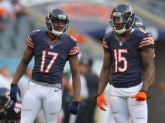 Aug 8, 2014; Chicago, IL, USA; Chicago Bears wide receiver Alshon Jeffery (L) and wide receiver Brandon Marshall (R) talk prior to a preseason game against the Philadelphia Eagles at Soldier Field. Mandatory Credit: Dennis Wierzbicki-USA TODAY Sports
