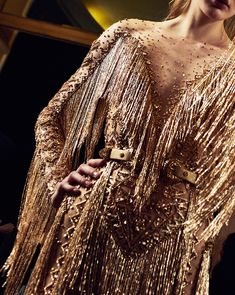 Backstage moments filled with golden fringes captured by @davidpicch #HauteCouture #ZuhairMurad #SS18