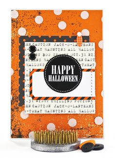 This Halloween card was designed with classic orange and black Halloween colors in mind.  The orange background paper has a bit of a grunge/distressed look but this is definitely far from being a scary happy Halloween card. The abundance of whimsical white polka dots makes sure of that. #thecardkiosk