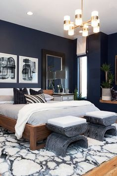 American Walnut touches and fresh, white marble are reoccurring materials that compliment darker features like Sherwin Williams' Naval Blue wall color in the master bedroom. We layered color, texture Blue And Gold Bedroom, Dark Blue Bedrooms, Blue Master Bedroom, Blue Rooms, Navy Bedrooms, Dark Blue Bedroom Walls, Dark Walls, Blue Feature Wall Bedroom, Dark Blue Feature Wall