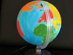 Géographie : globe et cartes des formations Montessori