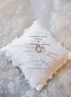 Have your wedding invitation put on a pillow for the ring bearer to carry or use it for a photo of your wedding rings tied together.