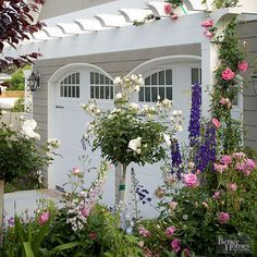 Glammed-Up Garage - clambering roses captivated BHG readers' attention. Opt for similarly distinctive doors and architecturally apt details to ensure your garage reads as part of your house rather than a utilitarian afterthought.