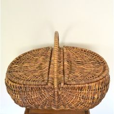 This vintage basket looks alot like our Jamaican hamper basket, just with a top
