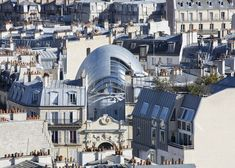 """Renzo Piano designs glass """"organic creature"""" to house Pathé Foundation   These photographs show the bulbous form of Renzo Piano's almost-complete Fondation Jérôme Seydoux-Pathé, which nestles within a Parisian urban block."""