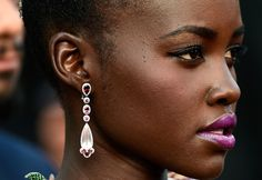 Lupita Nyong'o in pink quartz, rubelite and white diamond earrings by Chopard. The Cannes Film Festival 2015.