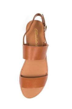 Casual double strap flat sandals with adjustable ankle buckle closure. Faux leather material. This style fits true to US size. - Imported