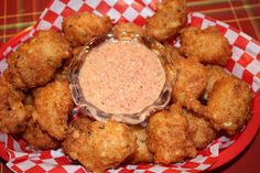 Fleur de Lolly: Crabmeat and Shrimp Fritters with Creole Tomato Dressing