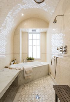 The Manhattan home of Uma Thurman features a Turkish steam bath and a sleek marble slab bench.