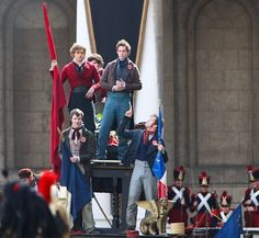 Les Mis (2012) | On the set: Aaron Tveit (Enjolras) and Eddie Redmayne (Marius).