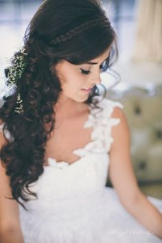 Amazing wedding hair style with long loose curls and a wrap around braid detail and sprigs of babys breath. So pretty!