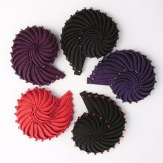 Petersham ribbon Nautilus brooches now in stock. Own little bit of millinery history or find the perfect gift for hat lovers. Full range available in store Embroidery Jewelry, Ribbon Embroidery, Kanzashi Flowers, Paper Flowers, Fabric Brooch, Art And Craft Design, Passementerie, Patterns In Nature, Red Glass