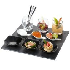 Sushi amuse bouche set. Amuse bouche set consists of 3 glasses with metal spoons, 3 ceramic spoons and 3 ceramic bowls presented on a slate plate. Presented in a Cardboard gift box. Wooden Slate, ceramic and glass....