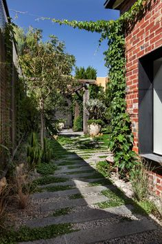 I LOVE this idea of having granite slabs, pebbles, and creepers laced throughout a yard. I think this would be a great idea for drainage a round our back patio, and then having a line where the drainage is good and the real grass starts // Baffle House by Clare Cousins Architects | Yellowtrace