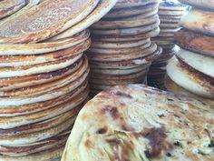 Uzbekistan tourism - piles of bread at an outdoor market