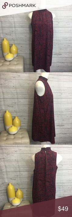"""1.State Small sleeveless tunic dress red cordovan 1.State size small sleeveless red cordovan modern scrolls slip on lightweight tunic dress. 100% Polyester. Bust 19"""" armpit to armpit Waist 20"""" side to side Hips 21"""" 34"""" side to side Length shoulder to hem. Measurements are approximate. 1. State Dresses"""