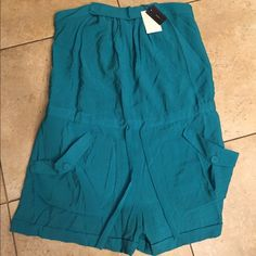 BCBGMaxAzria NWT romper size 12 NWT romper has front pocket detail an elastic back for the perfect fit Size 12 retail tags attached no flaws BCBGMaxAzria Pants Jumpsuits & Rompers