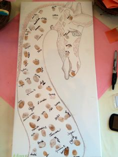 """could totally do this with a whale shark!   """"My husband drew this giraffe on a canvas to use as a guestbook for my girlfriends baby shower. To make the giraffe's spots  we had the guests stamp their fingerprint and sign their name next to it. Cute cute!"""""""