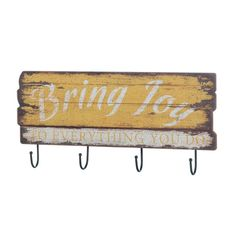 Bring joy and organization to any room with this cheery vintage-style wall decor. Four iron hooks hang from a yellow wooden sign that reads Bring Joy To Everything You Do. Bring Joy Wall Hook by Rustica House. #myRustica